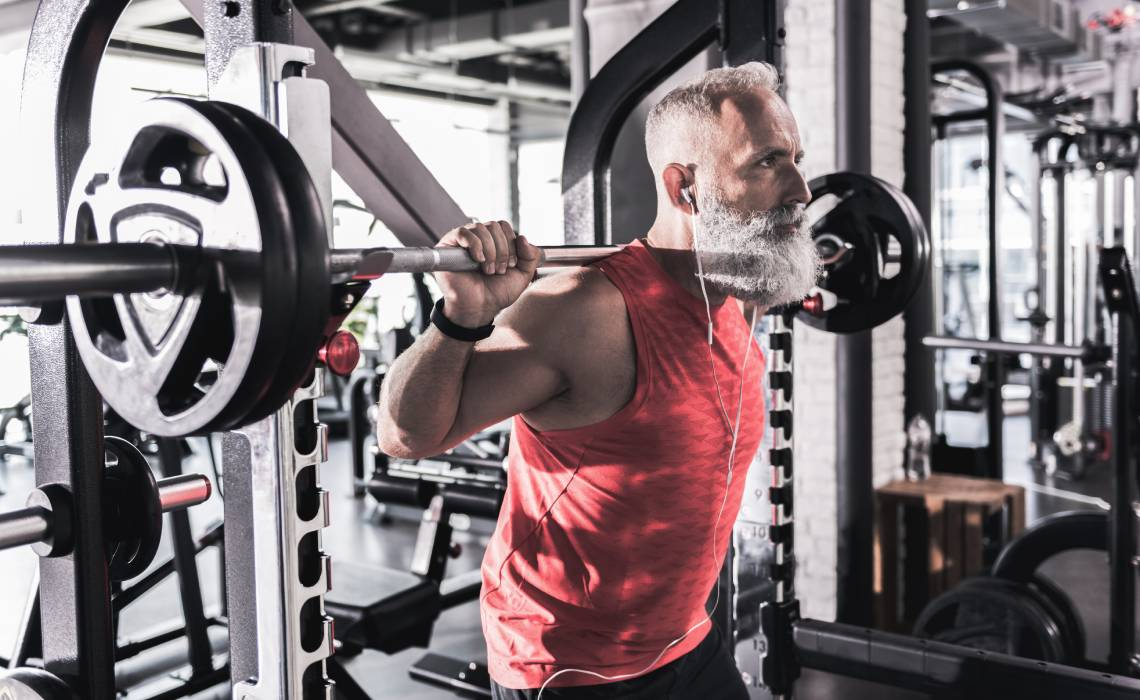 MX - 1140x700 -Older man in the gym doing weights.jpg